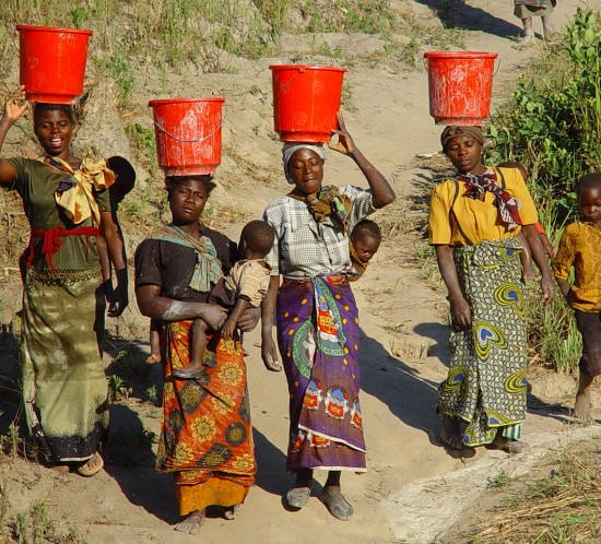 Women walking to well for water