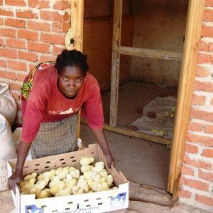 Mary Mwanza with chicks Lusangazi
