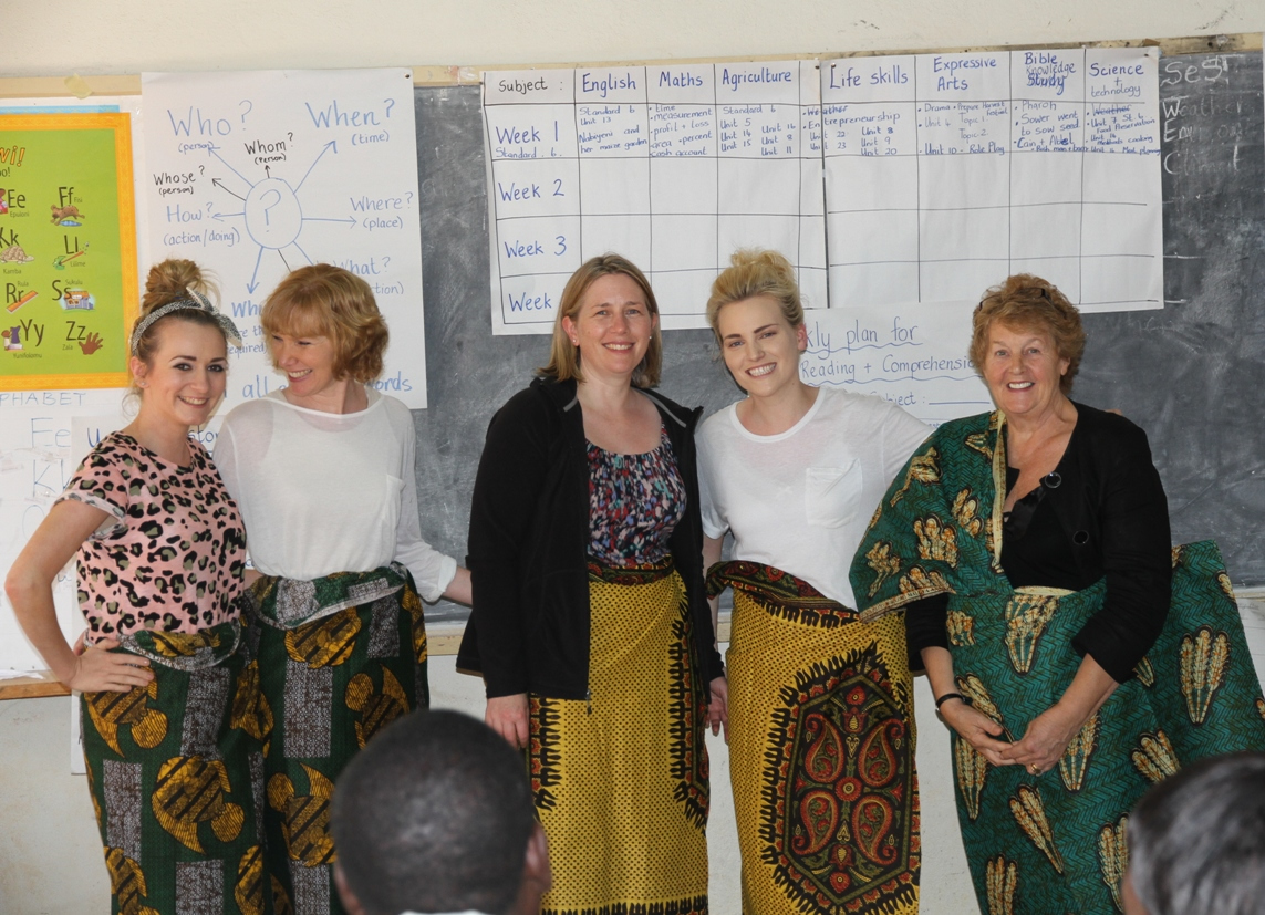 teacher volunteers with Mary in trad dress