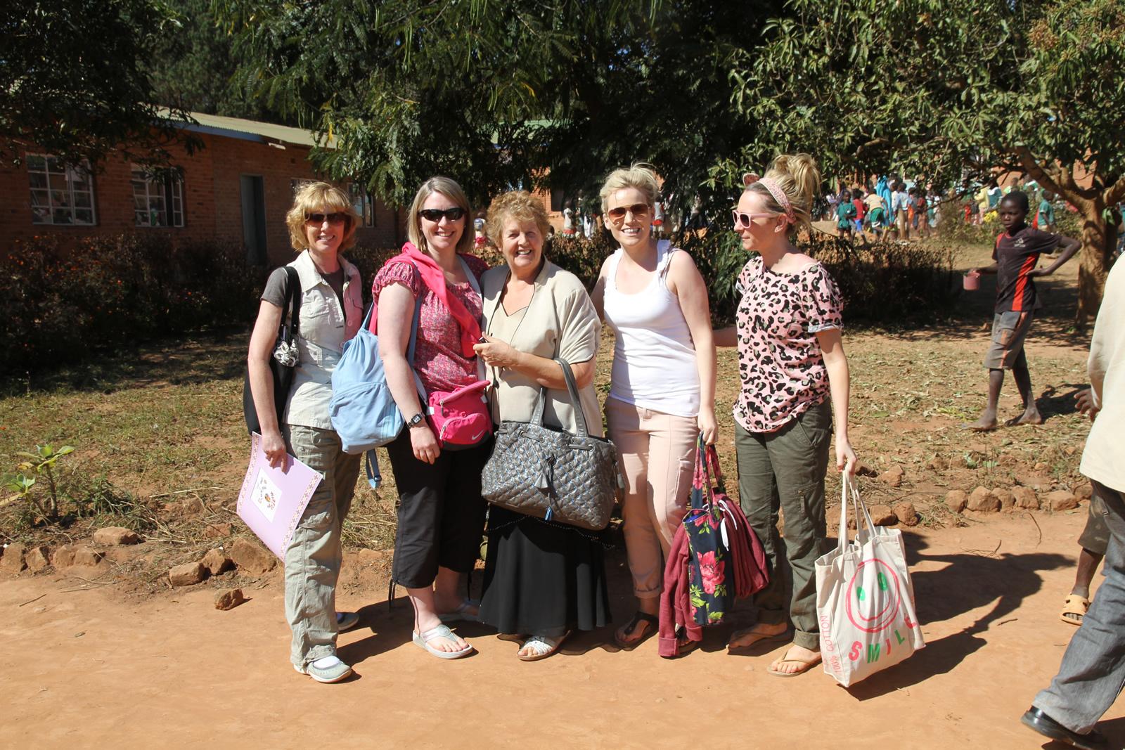 teacher volunteers with Mary