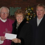 Fr. Larry White presents cheque to w4z