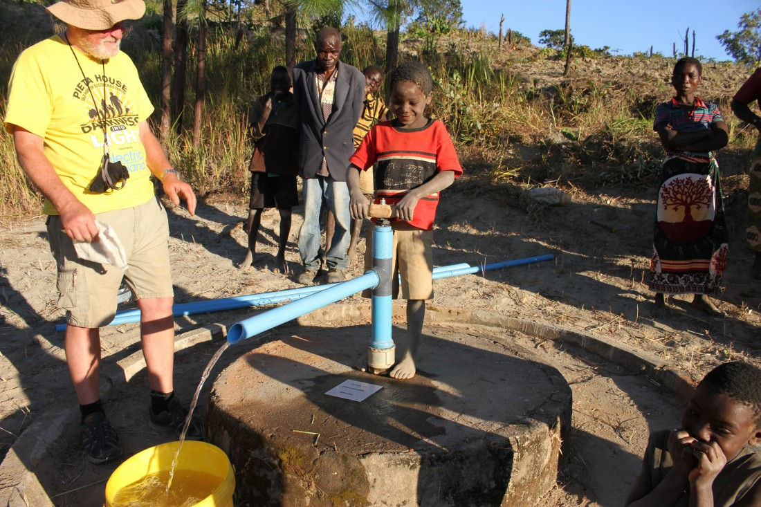 Cathal with child using the pump