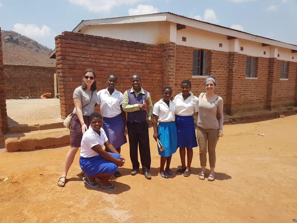 Wells for Zoë students at Enyezini school with teacher & Volunteers Laura and Aine