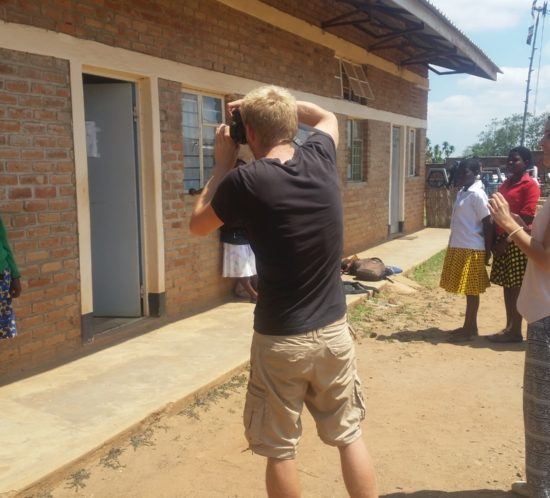 Kevin & Cristina taking photos of the new Girl Child Students