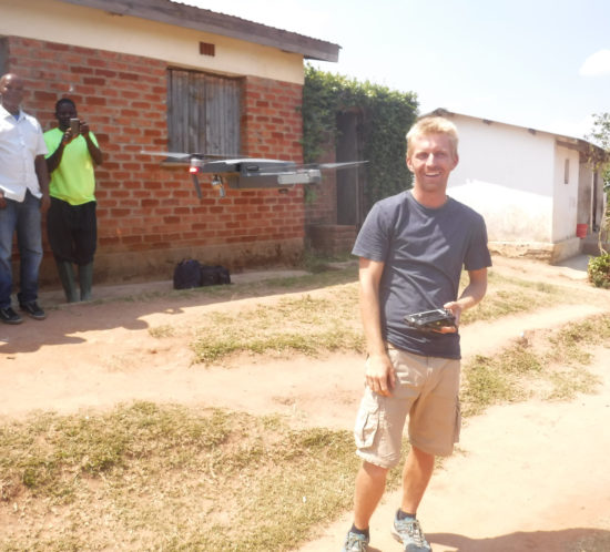 Kevin at Lusangazi farm with drone