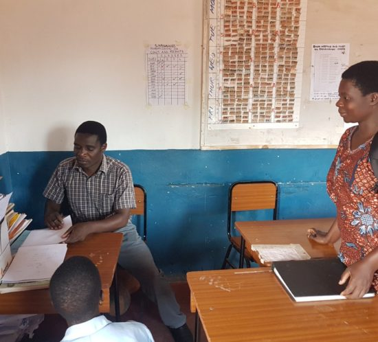 Florence catching up with WfZ girls coordinator Mr. Nkosa, in Lupaso