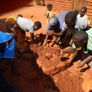 5. village women building large stove with Peter